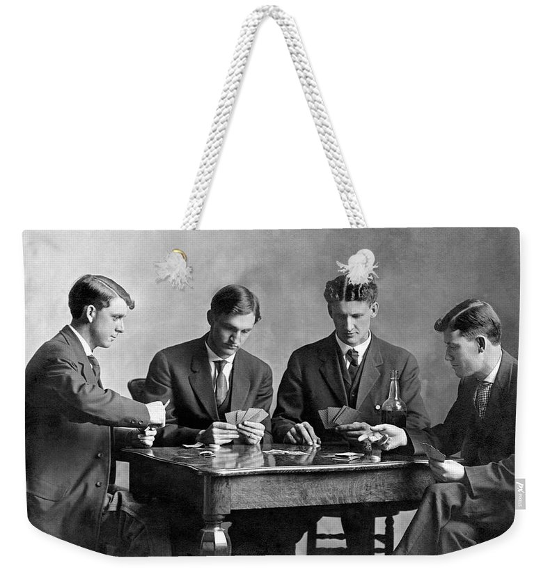 1035-331 Weekender Tote Bag featuring the photograph Four Men Playing Cards by Underwood Archives