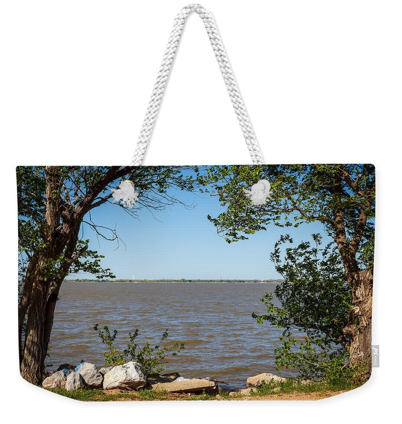 Horizontal Weekender Tote Bag featuring the photograph Framed by Doug Long