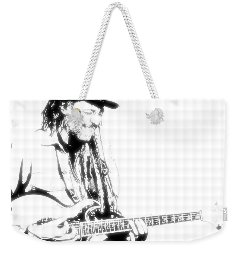 Singers Weekender Tote Bag featuring the photograph Freddy And His Guitar by Lyriel Lyra