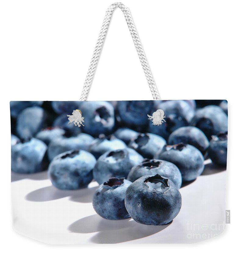 Blueberries Weekender Tote Bag featuring the photograph Fresh And Natural Blueberries Close Up On White by Olivier Le Queinec