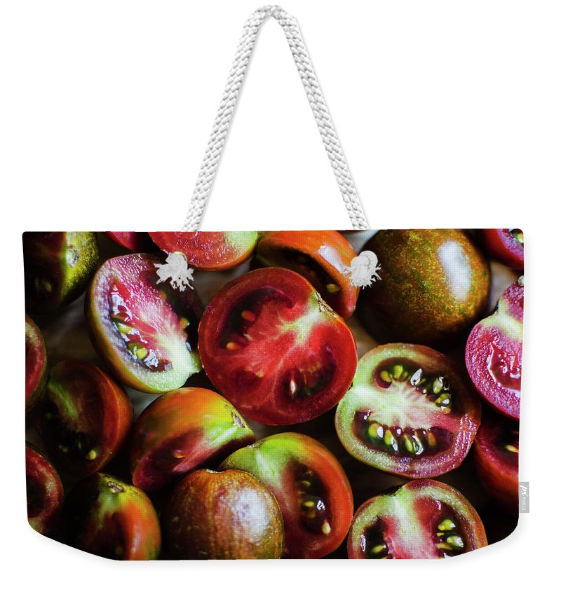 Tranquility Weekender Tote Bag featuring the photograph Freshly Cut Tomatoes by Jamie Grill