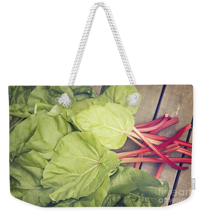 Rhubarb Weekender Tote Bag featuring the photograph Freshly Picked Rhubarb by Sophie McAulay
