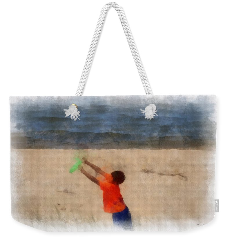 Frisbee Weekender Tote Bag featuring the photograph Frisbee On The Beach Photo Art by Thomas Woolworth
