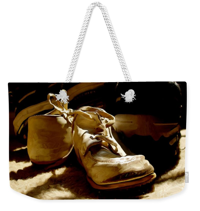Shoe Weekender Tote Bag featuring the photograph From Baby To Man In The Blink Of An Eye by Lois Bryan