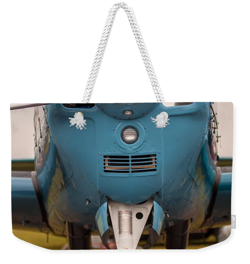 Action Weekender Tote Bag featuring the photograph Front Of An Airplane Propeller by Alex Grichenko