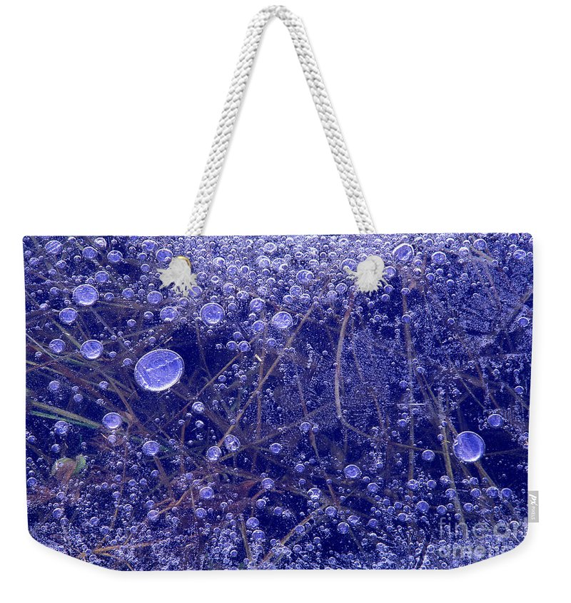 North America Weekender Tote Bag featuring the photograph Frozen Bubbles In The Merced River Yellowstone Natioinal Park by Dave Welling