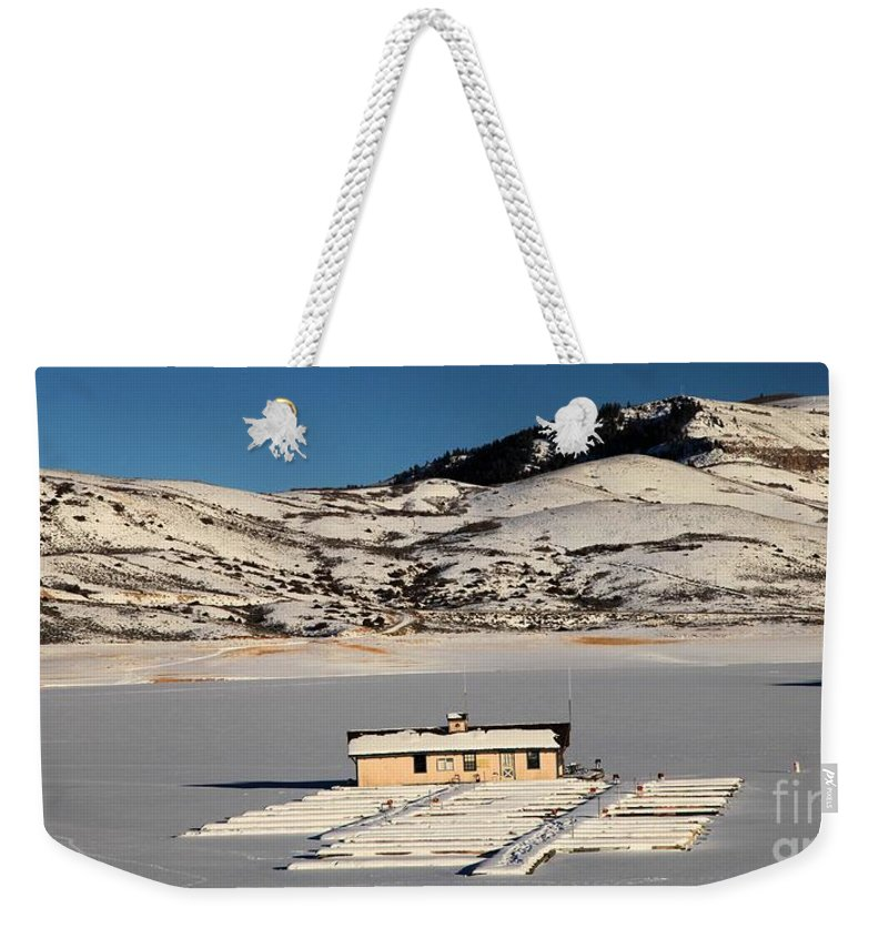 Blue Mesa Reservoir Weekender Tote Bag featuring the photograph Frozen Dock by Adam Jewell