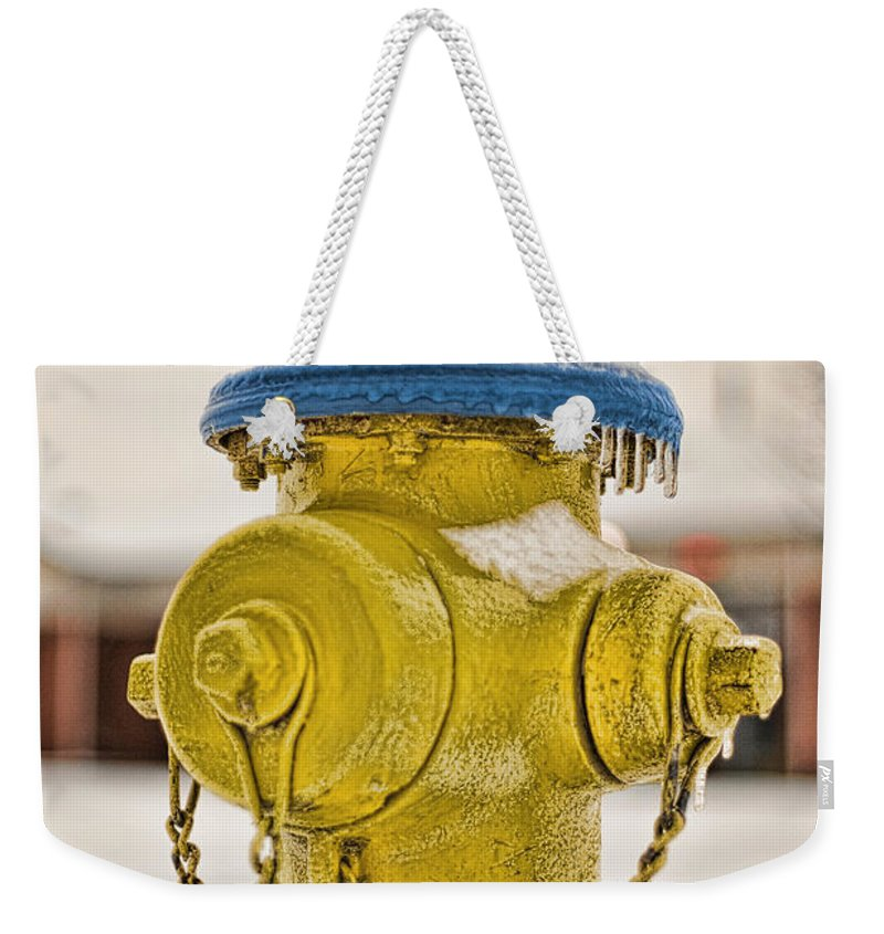Fire Hydrant Weekender Tote Bag featuring the photograph Frozen Fire Hydrant by Brett Engle