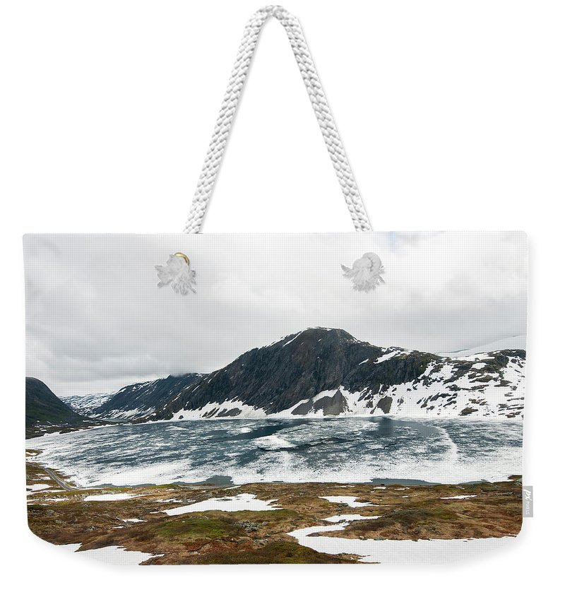 Tranquility Weekender Tote Bag featuring the photograph Frozen Lake - Dalsnibba Mountains by Thierry Dosogne