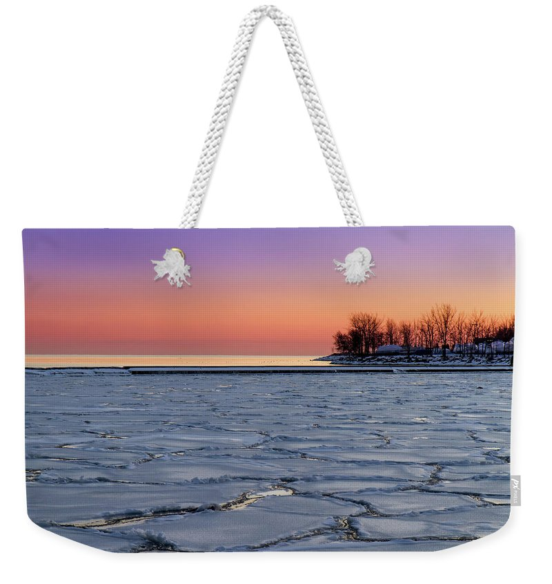 Scenics Weekender Tote Bag featuring the photograph Frozen Lake Ontario Sunset by Frank Lee