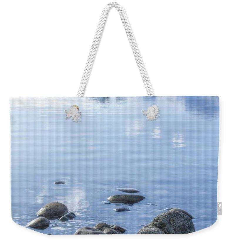 Jokulsarlon Weekender Tote Bag featuring the photograph Frozen Serenity by Evelina Kremsdorf