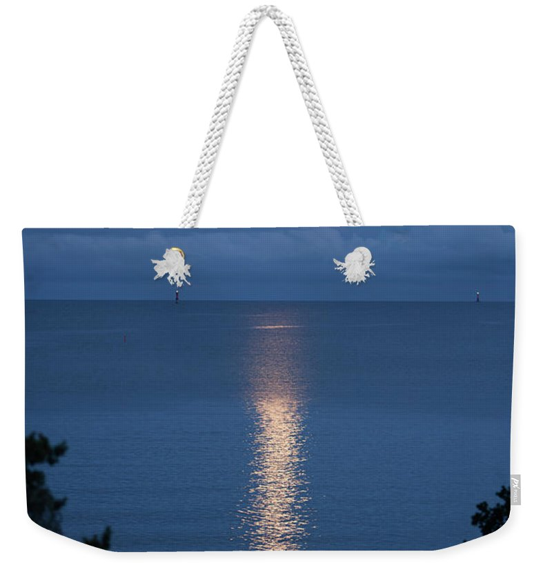 Archipelago Weekender Tote Bag featuring the photograph Full Moon Over Sea by Johner Images