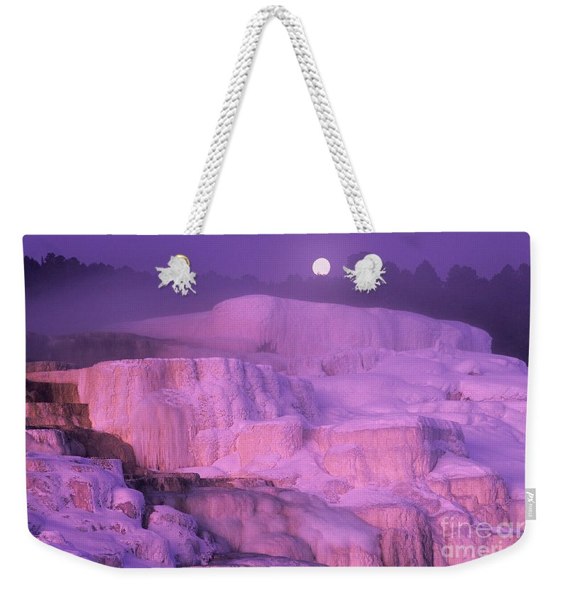 North America Weekender Tote Bag featuring the photograph Full Moon Sets Over Minerva Springs On A Winter Morning Yellowstone National Park by Dave Welling