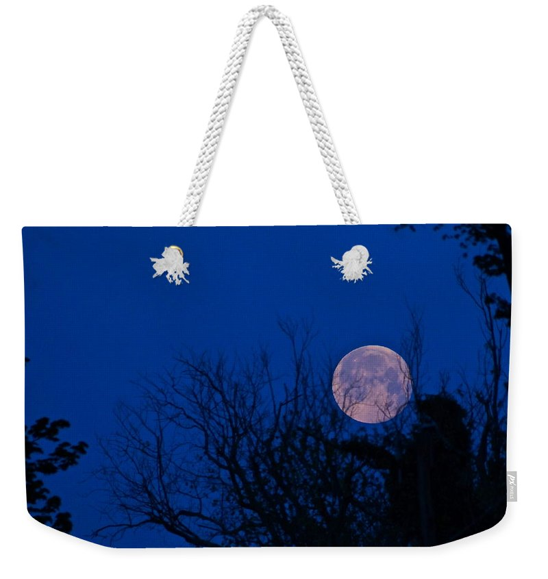 Moonset Weekender Tote Bag featuring the photograph Full Moon With Trees by Byron Varvarigos