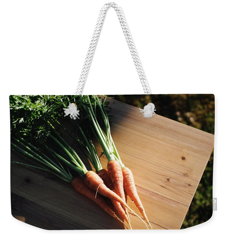 Five Objects Weekender Tote Bag featuring the photograph Garden Carrots On Sunny Stool by Danielle D. Hughson