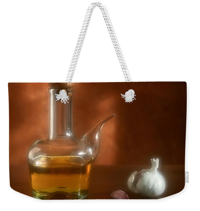 Garlic Weekender Tote Bag featuring the photograph Garlic And Olive Oil. by Juan Carlos Ferro Duque