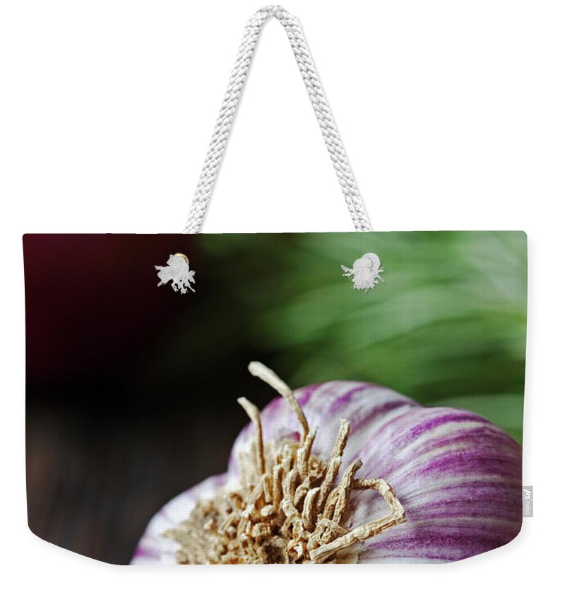 Wood Weekender Tote Bag featuring the photograph Garlic And Vegetables On A Rustic by John W Banagan