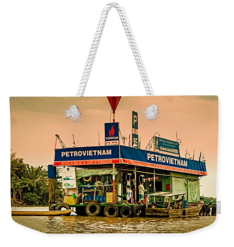 Blue Weekender Tote Bag featuring the photograph Gas Station Vietnam Style by Mark Llewellyn