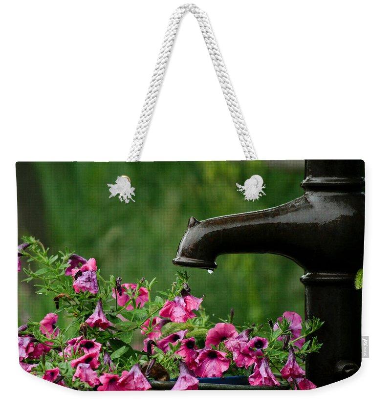 Gentle Rain Weekender Tote Bag featuring the photograph Gentle Rain - Old Water Pump - Pink Petunias - Casper Wyoming by Diane Mintle