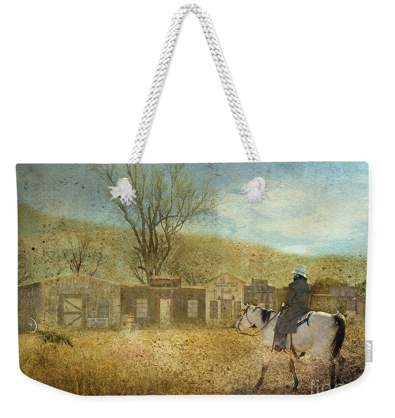 Cowboy Weekender Tote Bag featuring the photograph Ghost Town #1 by Betty LaRue
