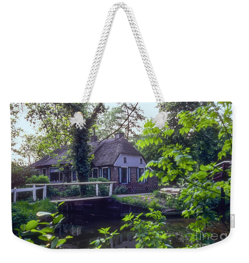 Giethoorn Thatched House Houses Home Home Bridge Bridge Canal Canals Tree Trees Water Building Buildings Structure Structures Architecture Landscape Landscapes Holland Netherlands Weekender Tote Bag featuring the photograph Giethoorn Thatch by Bob Phillips