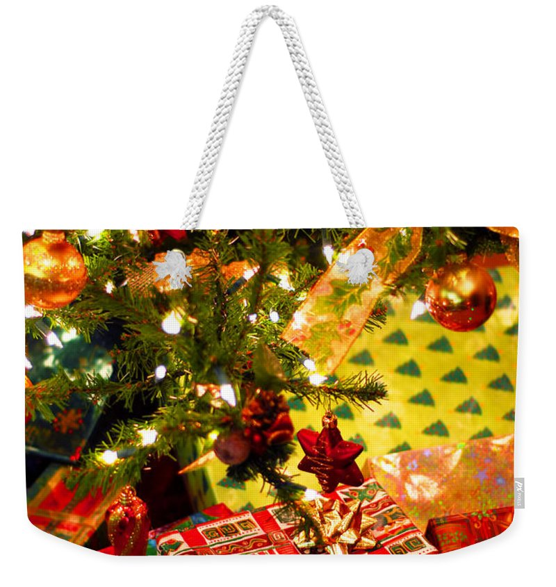 Christmas Weekender Tote Bag featuring the photograph Gifts Under Christmas Tree by Elena Elisseeva