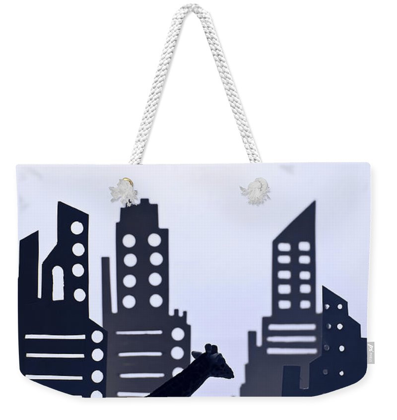 White Background Weekender Tote Bag featuring the digital art Giraffe Walking Around The City by Dina Belenko Photography