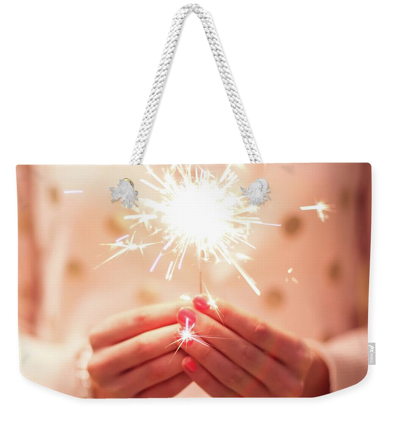 Firework Display Weekender Tote Bag featuring the photograph Girl Holding Small Sparkler by Sasha Bell