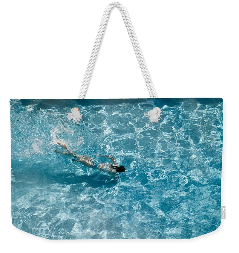 Girl Weekender Tote Bag featuring the photograph Girl In Pool by Peter Lloyd