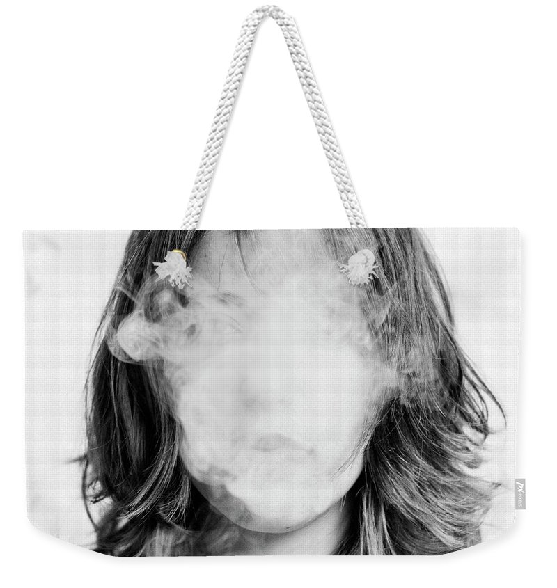 People Weekender Tote Bag featuring the photograph Girl Smoking by Lita Bosch