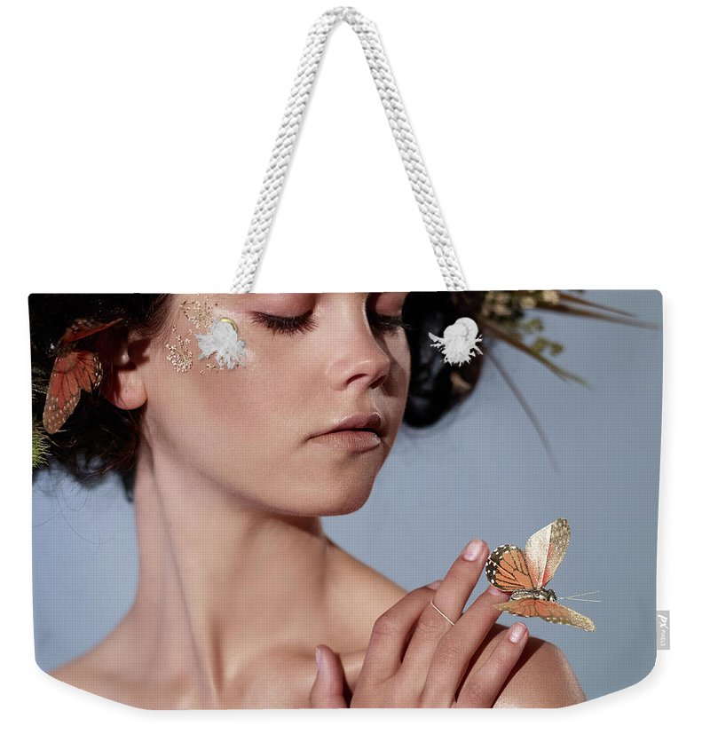 Tranquility Weekender Tote Bag featuring the photograph Girl With Butterfly In Hand by Bill Diodato