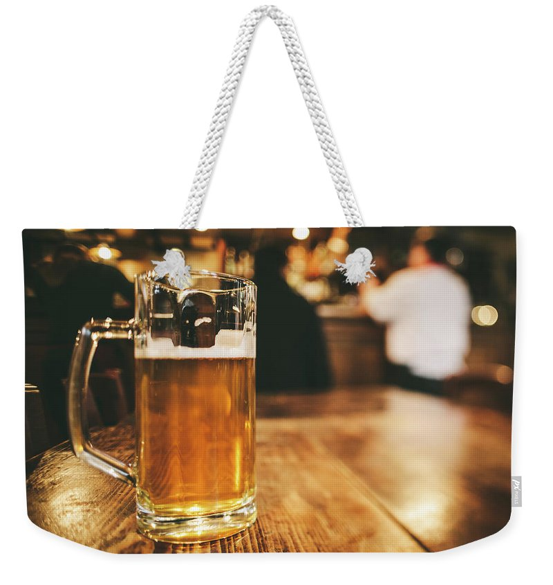 Alcohol Weekender Tote Bag featuring the photograph Glass Of Bier, Brewery In Germany by Moreiso