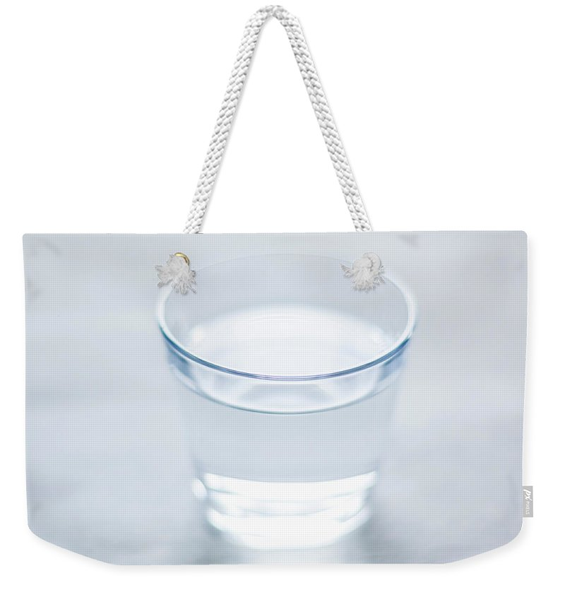 White Background Weekender Tote Bag featuring the photograph Glass Of Water by Steven Errico