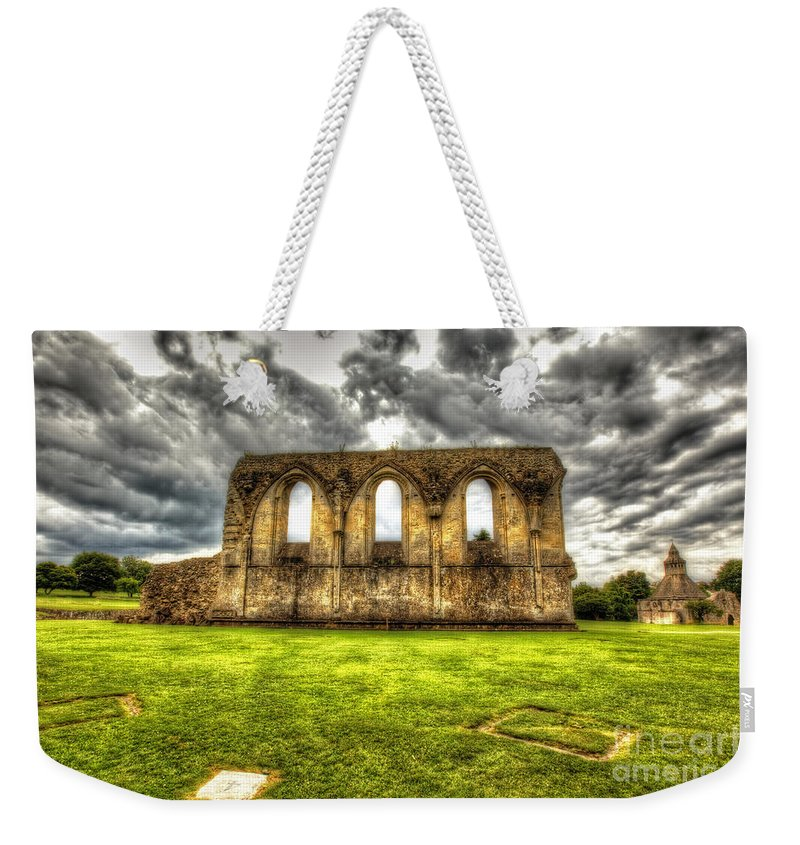 Glastonbury Weekender Tote Bag featuring the photograph Glastonbury by Traci Law