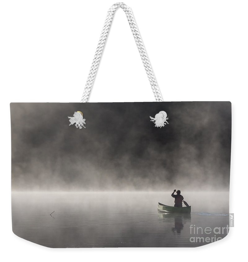 Canoeing Weekender Tote Bag featuring the photograph Gliding Through The Mist by Barbara McMahon
