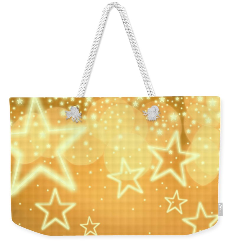 Christmas Lights Weekender Tote Bag featuring the photograph Glowing Background With Stars, Studio by Tetra Images