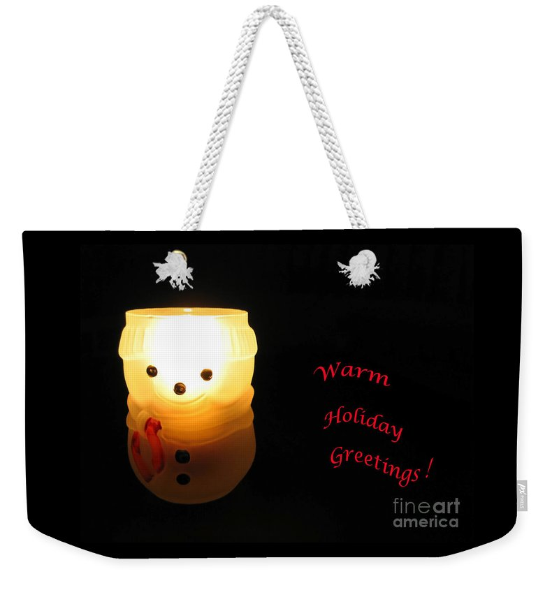 Snowman Weekender Tote Bag featuring the photograph Glowing Snowman by Ann Horn