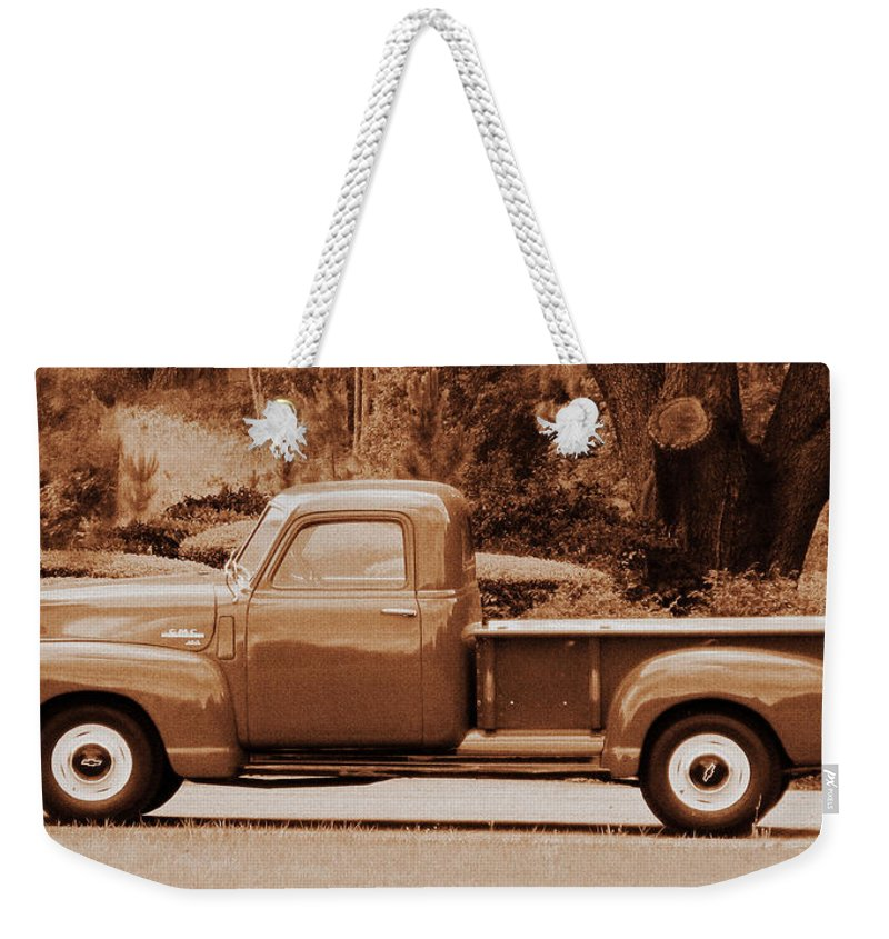 Antique Weekender Tote Bag featuring the photograph Gmc 100 by Peg Urban