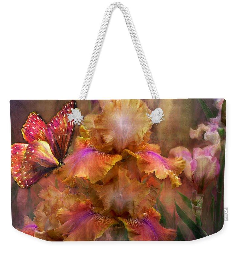 Iris Weekender Tote Bag featuring the mixed media Goddess Of Sunrise by Carol Cavalaris