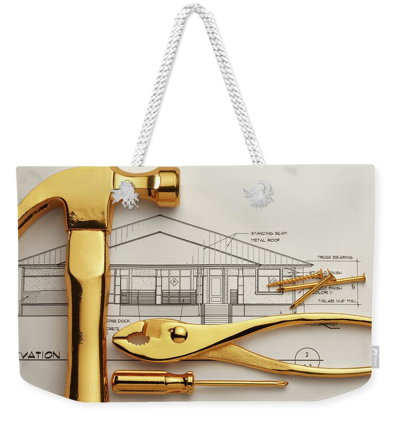 Plan Weekender Tote Bag featuring the photograph Gold Plated Tools And Blueprints by Dny59