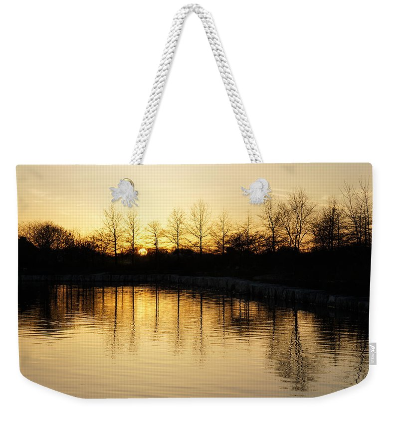 Golden Weekender Tote Bag featuring the photograph Golden And Peaceful - A Sunset On Lake Ontario In Toronto Canada by Georgia Mizuleva