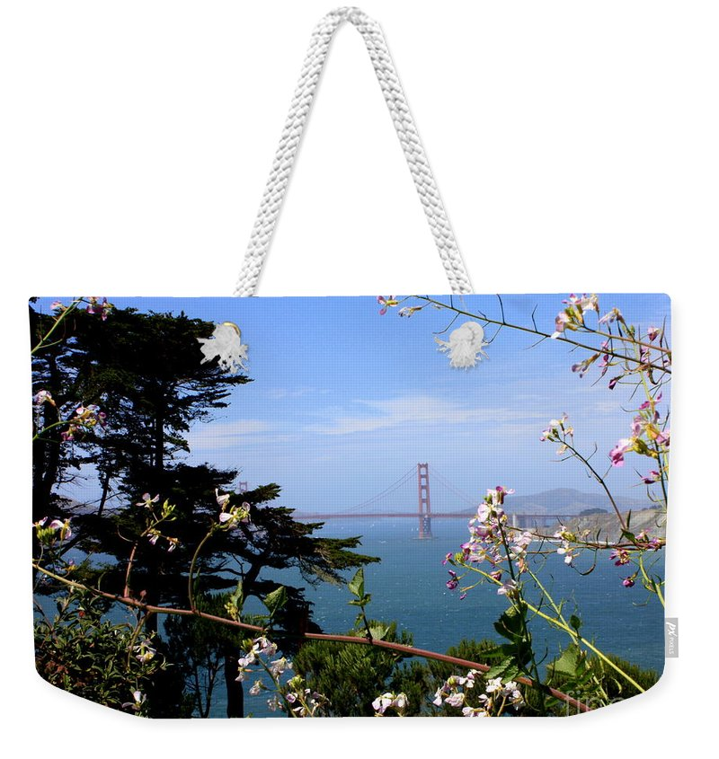 San Francisco Weekender Tote Bag featuring the photograph Golden Gate Bridge And Wildflowers by Carol Groenen