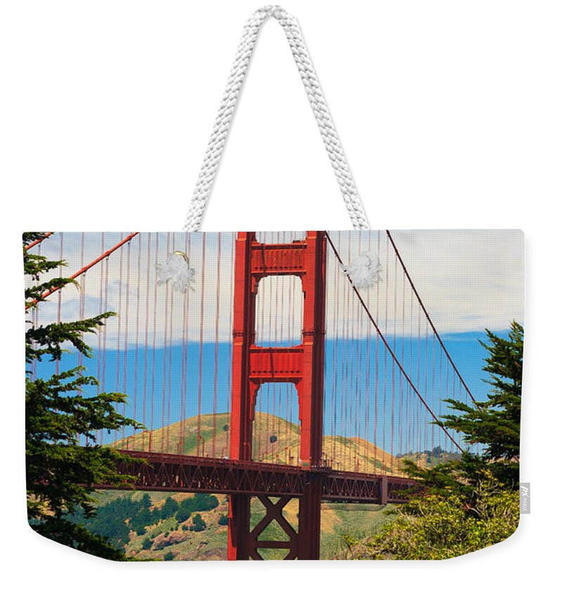 Architecture Weekender Tote Bag featuring the photograph Golden Gate Bridge by Raul Rodriguez