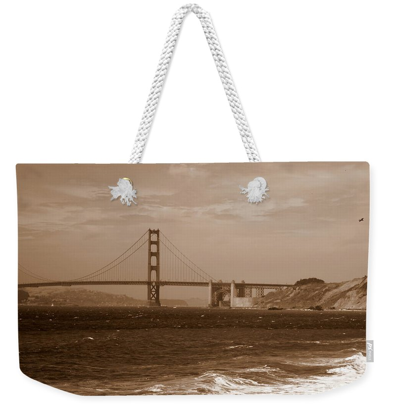 Golden Gate Bridge Weekender Tote Bag featuring the photograph Golden Gate Bridge With Surf Sepia by Carol Groenen
