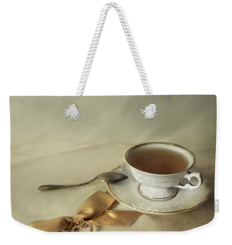 Still Life Weekender Tote Bag featuring the photograph Golden Key by Jaroslaw Blaminsky
