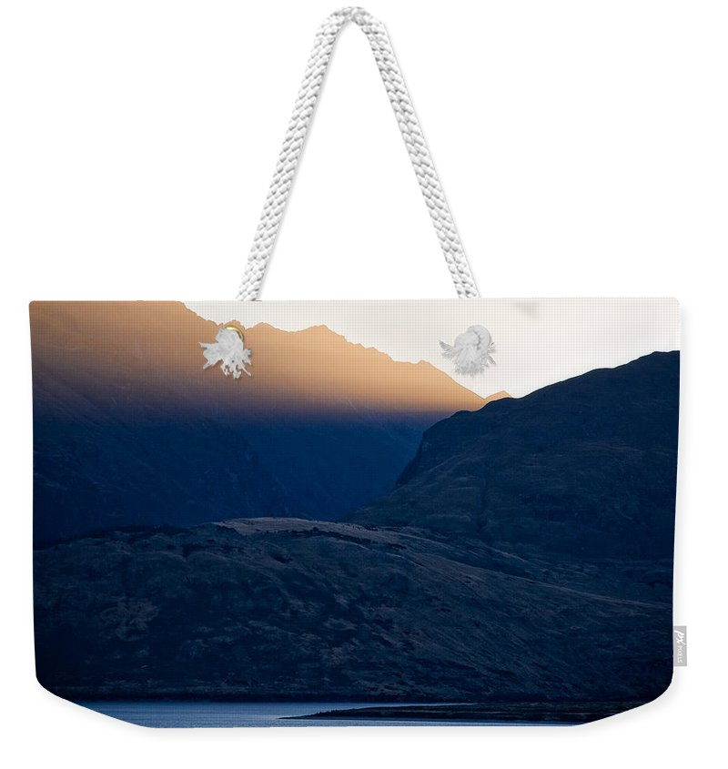 New Zealand Weekender Tote Bag featuring the photograph Golden Rays by Dave Bowman