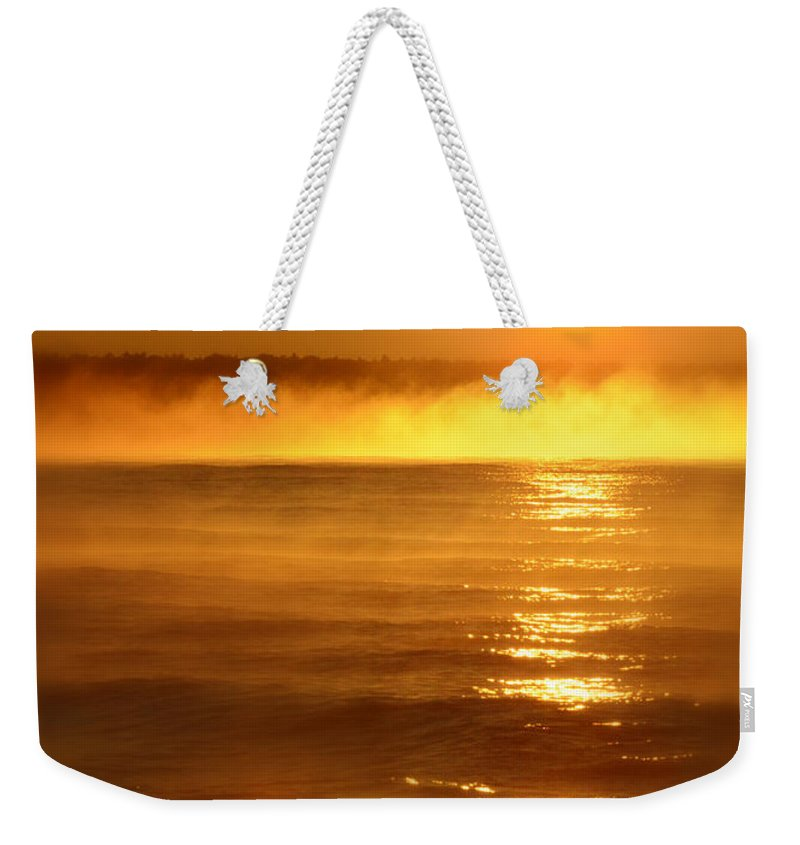 Lake Superior Weekender Tote Bag featuring the photograph Golden Sunrise Over The Water by Jill Battaglia