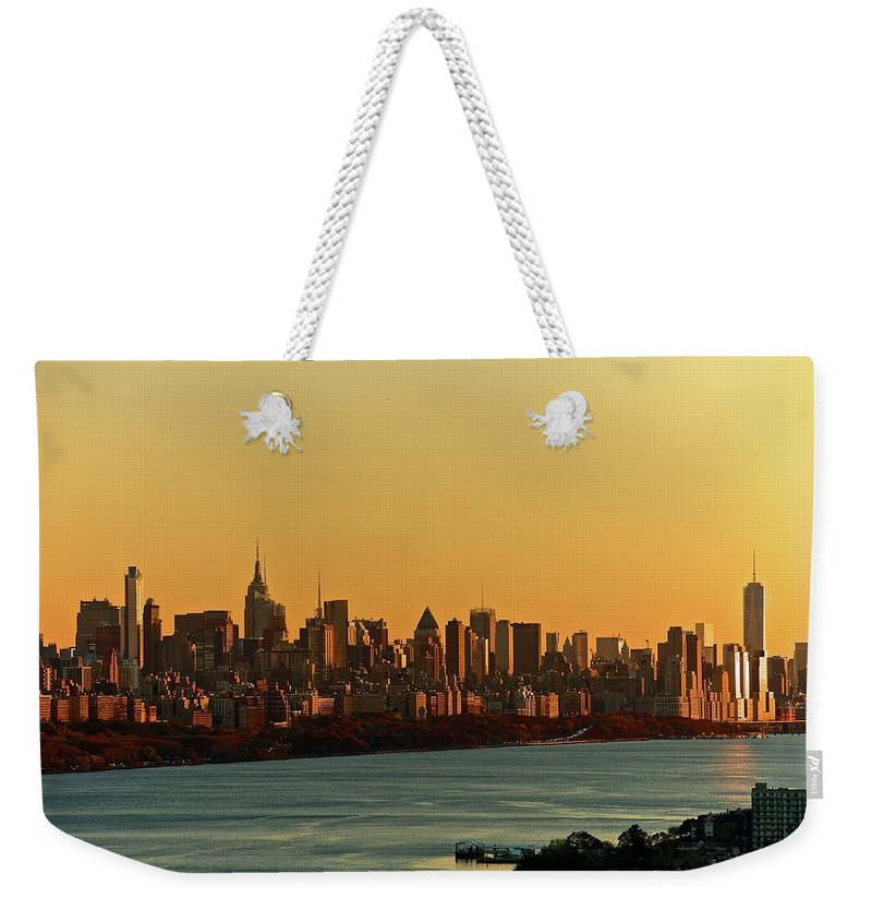 Tranquility Weekender Tote Bag featuring the photograph Golden Sunset On Nyc Skyline by Robert D. Barnes