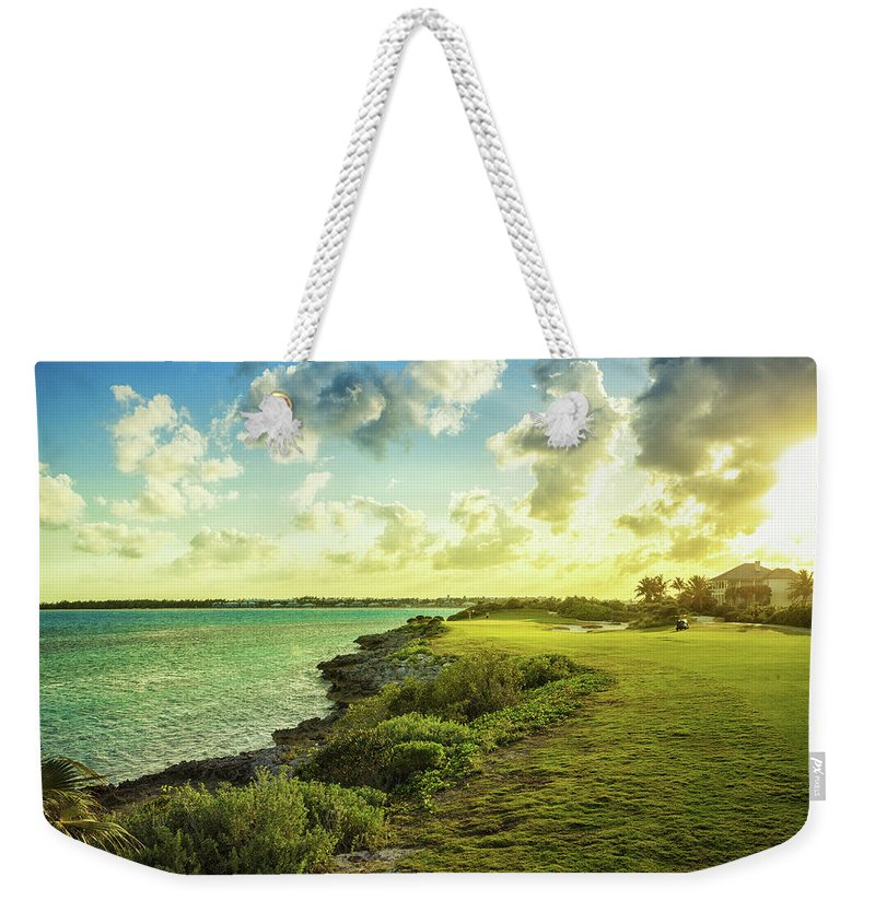Scenics Weekender Tote Bag featuring the photograph Golf Course by Chang