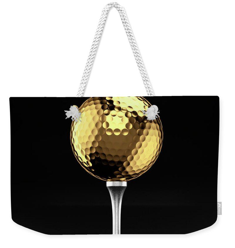 Two Objects Weekender Tote Bag featuring the photograph Golfball And Alluminium Golf Tee by Atomic Imagery